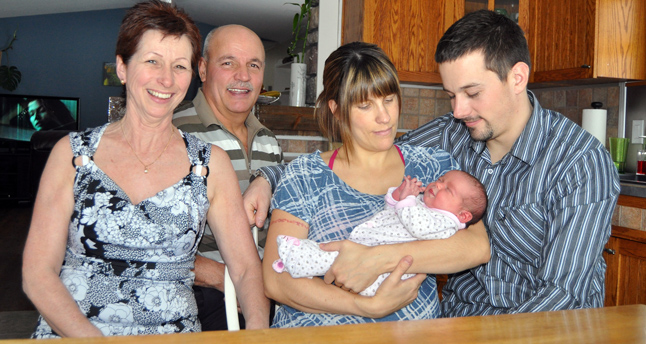Marie-Claude, Quintin and Anika pose with proud grandparents Madeleine and Rejean de Launiere of Lac St. Jean, Quebec. The only person missing from this family photo is Marie-Claude and Quintin's oldest child, two-year-old Kaden. David F. Rooney photo