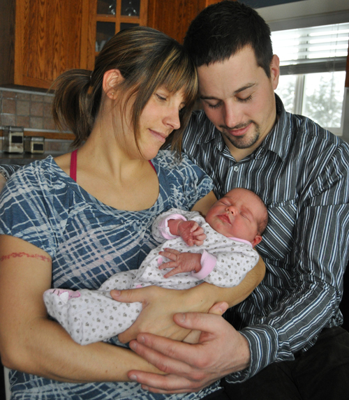 Marie-Claude and Quintin share a tender moment with their young family's newest addition. David F. Rooney photo