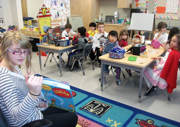 Grade 7 student Arden Davis reads to Linda Dickson's Kindergarten class  during Story Time at lunch. Eleanor Wilson photo