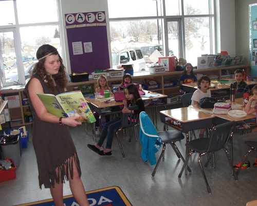 Grade 7 student Sailor Sabiston reads to the grade 1/2 students during Story Time at lunch. Eleanor Wilson photo