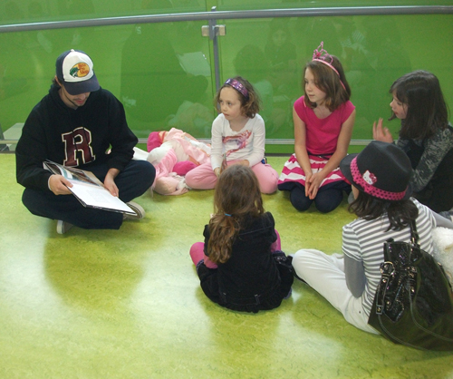 Grizzly Jordan Furlane reads with BVE students during Buddy Reading. Eleanor Wilson photo
