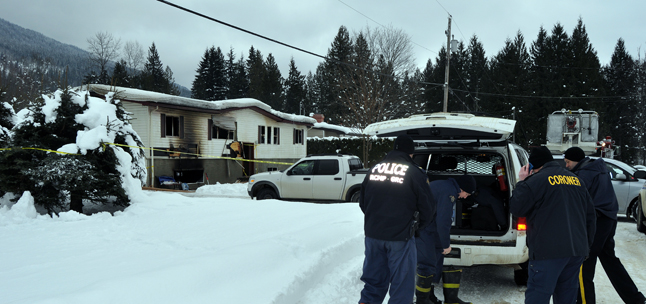 """Police, Fire Rescue and Coroner's Service officials prepare to retrieve the body of a man from the remains of this house on Tillen Road at noon on Thursday. """"All we can tell you right now is that it's a man,"""" said one Mountie at the scene. David F. Rooney photo"""