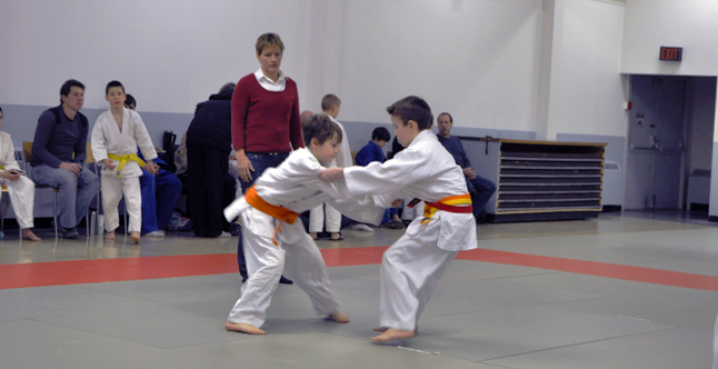 Young judokas Caine McCabe of Revelstoke and Ben Leatherdale of Kelowna jockey for position. David F. Rooney photo