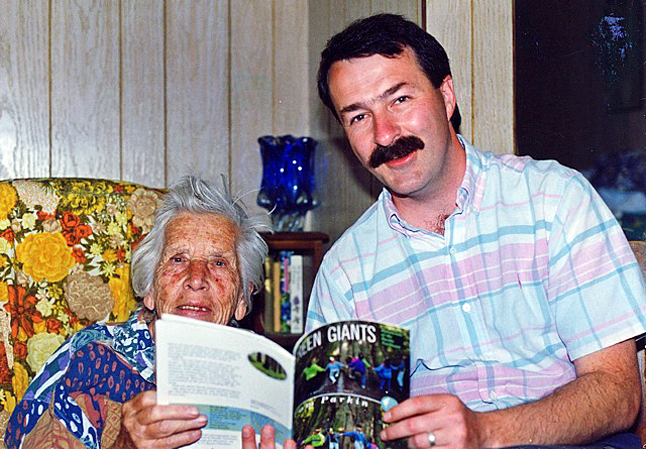 Eva Burn in her home with author Tom Parkin. Although crippled by arthritis at this time, she still lived independently and took an active interest in current and community affairs. Five years after this, she took up residence in the extended-care unit of Queen Victoria Hospital, where she ended her days at age 89. M. Zarichuk photo