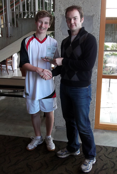 Gabe Laidlaw accepts his trophy from Jason Pyne, Athletic Service Manager for the Jericho Tennis and Squash Club, for taking second place in the Boys Under 15 B Division. Photo courtesy of Kevin Dorrius