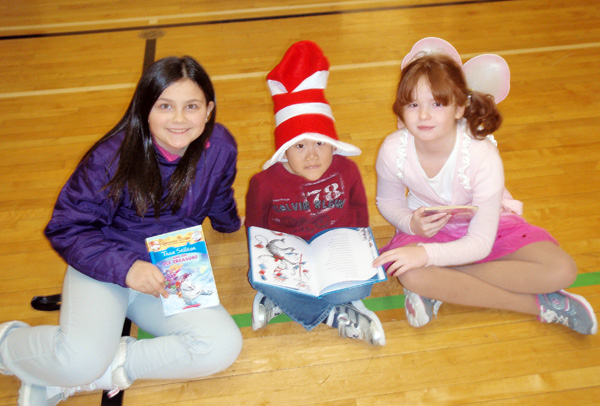 Cassidy Legebokow, Andrew Yoon, and Andie Reynolds are enjoying The Cat in the Hat in the gym on Literacy Day at Arrow Heights Elementary School on January 30. This day was excellent because kids were excited to read their favorite books and they showed the characters in the books that they loved.  Julian Corbett photo and caption