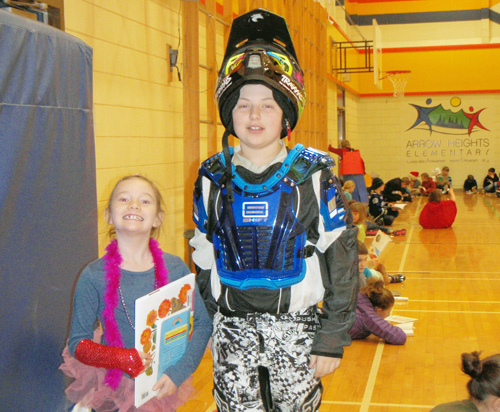 Mimi Kramer and Conner Templeton are in the gym on Literacy Day at Arrow Heights Elementary.  Students dressed up for the day in the costumes of characters from their favorite books to celebrate reading.  Julian Corbett photo and caption