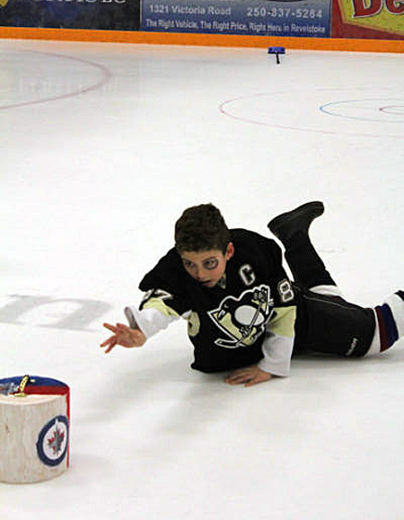 Look at my form! With enthusiastic style like this the sport of curling in now danger of dying out. Linda Chell photo