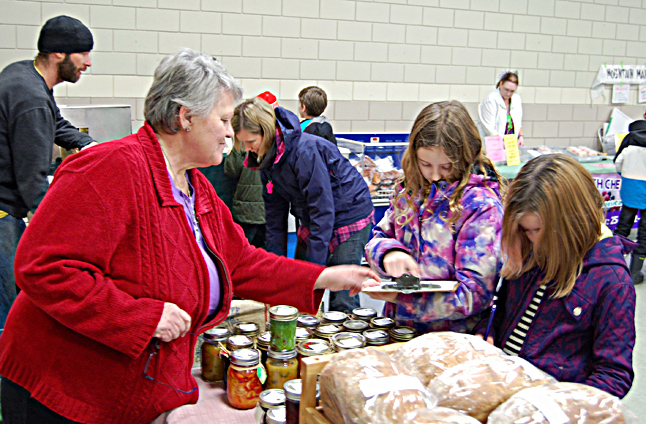 Savanah Karr and Marissa Brunetti were two of the kids on the Farm to Table Program field trip organized by the North Columbia Environmental Society. They met a lot of vendors, including Joylene Sulz who produces come very tasty breads and other bakes goods. David F. Rooney photo