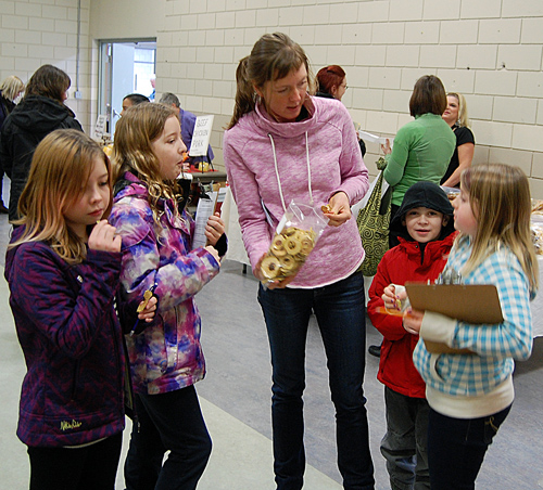 The NCES'as coordinator Hailey Ross shares her purchase of  terrific dried apples with Paige Makenzie, Kayden Lepine, Hailey Ross (you know!), Marissa Brunetti and Savanah Karr on the field trip. David F. Rooney photo