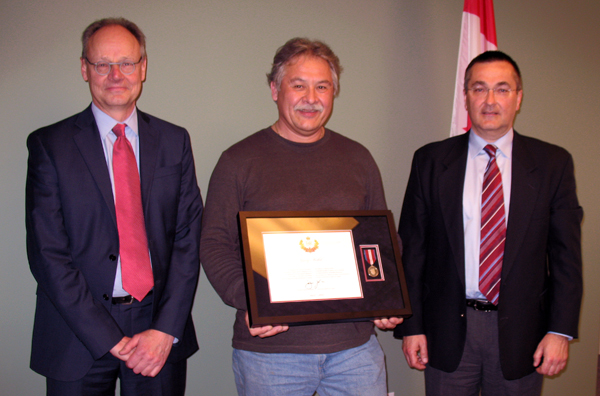 Thanks to his significant contributions to the Columbia Basin, Kimberley's Garry Merkel has received a Queen Elizabeth II Diamond Jubilee Medal. The former CBT board chairman (center) poses with his successor, Greg Deck (left), and CBT CEO Neil Muth (right) after receiving a Queen Elizabeth II Diamond Jubilee Medal for his contributions to the Basin. Photo courtesy of the CBT