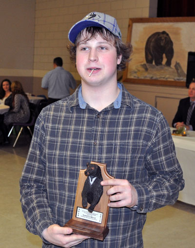 Dakota Brule shows off his First Place trophy for best black bear (17 3/8). That prize is sponsored by Kasbro Drilling and Blasting Ltd. David F. Rooney photo