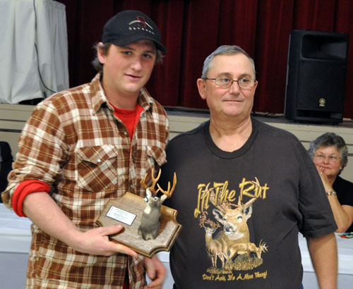 Charlie Keates picks up his trophy for the second-place (71) mule deer trophy. That award was sponsored by Skalicky's Plumbing and Gas Fitting. David F. Rooney photo