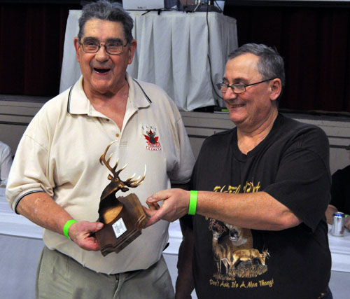 Clancy Boettger, who's well into his 80s picks up the trophy for the second-place elk (2721 3/8), which was sponsored by Brensrud Contracting. First place was taken by David Bungay. He also took the Rob Lenzi Memorial Trophy for the largest elk (283 2/8. The first-place trophy was sponsored by Sure Haul Transport Ltd. and the Rob Lenzi Memorial was sponsored by Kurt Schoefelder/Wright Machine. David F. Rooney photo