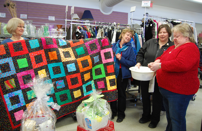 Jill Leslie and Sharon Cain hold the lovely quilt they made as a fundraiser for the Revelstoke Hospital Auxiliary and Cheryl Fry and Wendy Larson (right) draw the winners of the raffle. Kelly Cann won the quilt. Kathie MacKay won the second prize — a basket of gourmet coffees and Fly Boyes won the third prize basket of Green products. The draw raised $2,440 to support the Auxiliary's good works  in Revelstoke. No matter how you look at it, the Hospital Auxiliary Society does a marvellous job of raising money to support seniors, sick people and others in dire need in our community. They are also a major donor to the Ambulance Service, the Fire and Rescue Service, Mount Cartier Court and the hospital. Here's what they did last year: DONATIONS 2012 Community Connections Food Bank$12, 000.00 Community Connections $1,000.00 Revelstoke Senior Citizens Association$1,000.00 Revelstoke Community Foundation$1,539.27 Revelstoke District Health Foundation$2,000.00 BC Cancer Foundation$75.00 Heart & Stroke Foundation$75.00 EQUIPMENT PURCHASED 2012 Revelstoke Ambulance Service$9,531.20 Revelstoke Highway Rescue Services $11,499.65 Mt. Cartier Court$5,794.36 Queen Victoria Hospital$120,771.50 Total$165, 279.68 That's a terrific effort and it's possible because they are heavily supported by local people… folks like you! Just one more note of interest: this is the third quilt Jill and Sharon have created to benefit fundraising efforts in our community. My hat's off to you ladies. David F. Rooney photo