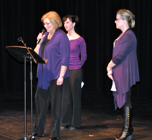 Nelli Richardson, Stephanie Melnyk and Otti Brown of the Women's Shelter and the Community Response Network greet the audience and thank they for attending the Revelstoke Rising. David F. Rooney photo