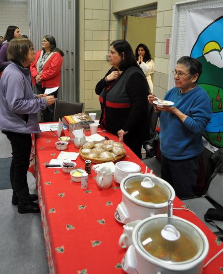Jane Morris (left) chats with Lynne Barisoff at the Metis food stand at the Carousel of Nations. David F. Rooney photo