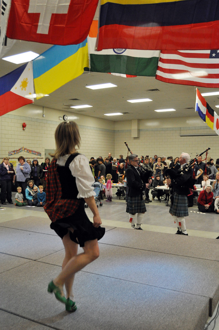 Cathy Cameron Suchy performs a traditional Scottish dance to the skirling music of the Highlanders' pipes. David F. Rooney photo