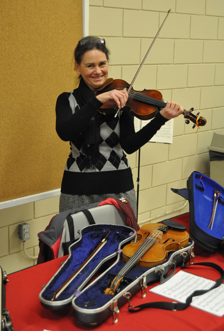Violinist Donna Peterson prepares to play her favourite instrument. David F. Rooney photo