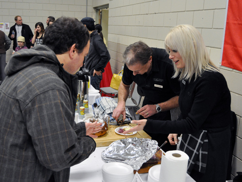 Crescendo's Shelly Isfeld and her boss, Daniel Weber,  served up treats created with the shop's exquisite selection of fine oils, spices and vinegars. David F. Rooney photo