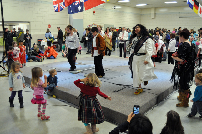 Members of the Li Jigeurs Machis dance troupe from Golden perform a traditional Metis broom dance that prompted some of the many kids at the Carousel of Nations to join in. David F. Rooney photo