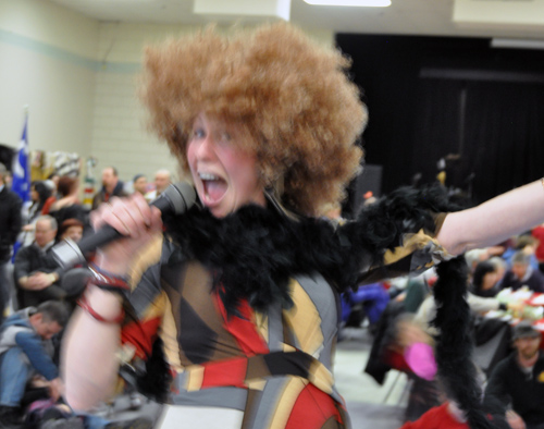 Amy Flexman was so busy as MC at the Carousel of Nations that she would only register as fright-wigged blur on my camera. David F. Rooney photo