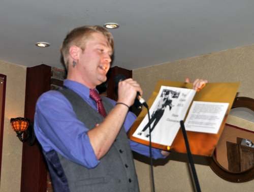 Ben Jammin tells the  crowd about a Top Bloke from out of the mists of Revelstoke's past. David F. Rooney photo