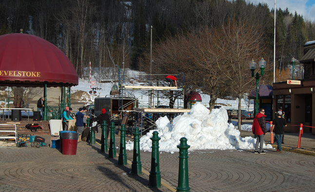 Saturday saw a gaggle of workers striving to turn Grizzly Plaza into the perfect spot for a Rail Jam. The snow, of course, had to be trucked in. David F. Rooney photo