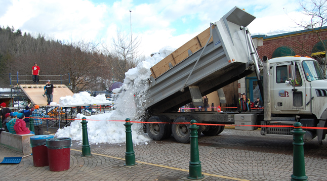 Another truck dumps its load. David F. Rooney photo