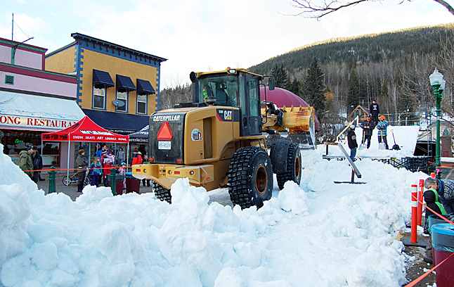 Meanwhile, more and more snw was being dumped to build the Rail Jam ramp. David F. Rooney photo