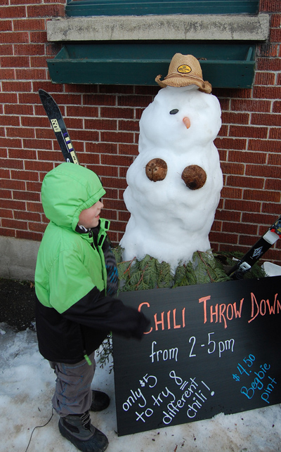 """""""Look Nanny! This snow man only has one eye."""" Cooper Horning thought the snowman, her snowchick, at Ginger & Spice was quite amusing. David F. Rooney photo"""
