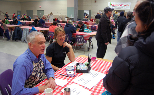 Alan Dennis and and Zuzana Driediger were the friendly faces greeting people attending the Spirit Fest 2013 Wrap-Up Spaghetti Dinner put on as a fundraiser by the Revelstoke Canine Search and Rescue Society on Sunday evening. David F. Rooney photo