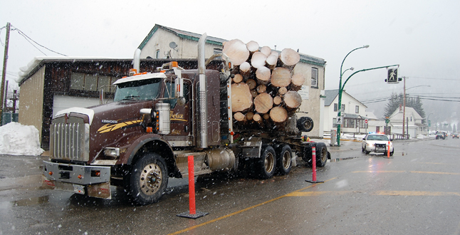 Here's something you don't see every day. This logging truck was turning from Fourth Street onto Victoria Road when it tipped its load. David F. Rooney photo