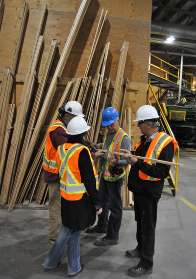 Smythe explains how laminated wood products are created at Selkirk Cedar. David F. Rooney photo