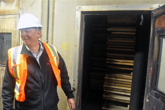 Doug Clovechok laughs after getting snoot-fiull of heated and steamy air when the door one of the wood kilns is opened for expression. All in all, Clovechok was greatly impressed by what he saw. If anything, he'd like to get Premier Christy Clark to see one of BC's economic success stories. David F. Rooney photo