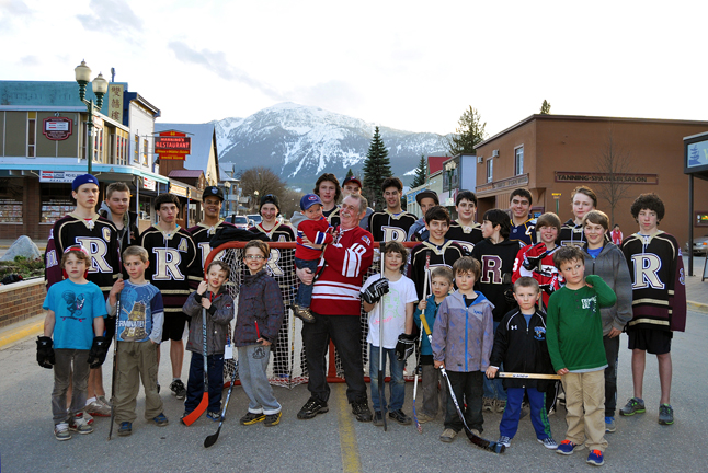 Dennis holds his grandson AJ as he poses with some of the kids who will benefit from his winning $20,000 for Revelstoke Minor Hockey. David F. Rooney photo