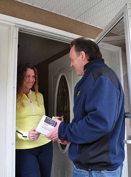 NDP candidate and incumbent MLA Norm Macdonald talks with Joanne Scarcella while doorknocking on Saturday. Most doorknocking is conducted by volunteers. Political candidates, like Macdonald, personally visit as many houses as they can. David F. Rooney photo