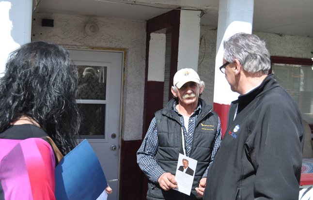 BC Liberal Candidare Doug Clovechok has been doorknocking all over town since he arrived here last week. On Sunday he went visiting in Southside with Angela Waterson (left). Here he chats with John Bafaro. David F. Rooney photo