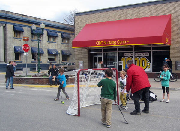 Dennis does what he loves best — encouraging young kids as they play. Laurie Berarducci photo