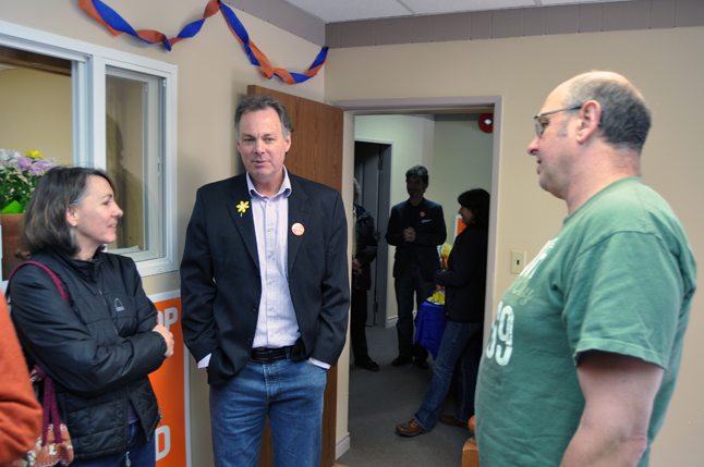 Norm Macdonald (center) talks with supporters Debbie and Gord Robinson during the opening of his campaign office at 2B 300 First Street West on Sunday. This is Macdonald's third election campaign. He says British Columbians want government by a party that is competent and trustworthy. David F. Rooney photo