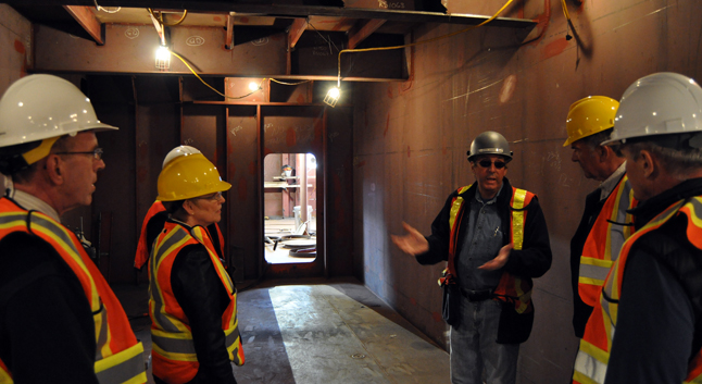 NAKUSP — Harding tells his visitors about the project's progress. David F. Rooney photo