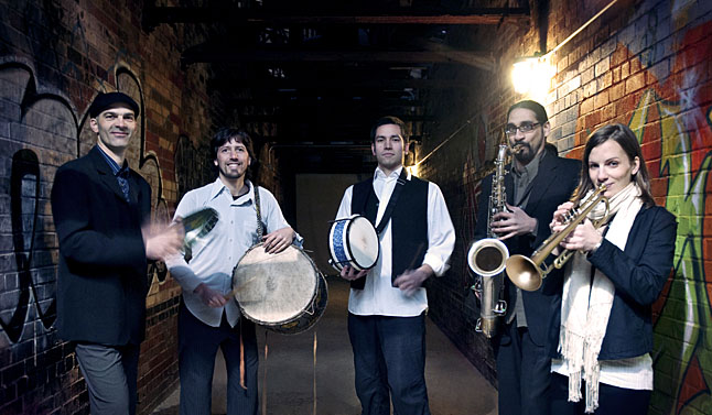 The dynamic percussion dance jazz orchestra known as DRUMHAND, will be performing at Powder Springs on July 12. This promises to be an exciting hos and you can learn more about them online at http://www.reverbnation.com/rpk/1056559. Photo courtesy of DRUMHAND