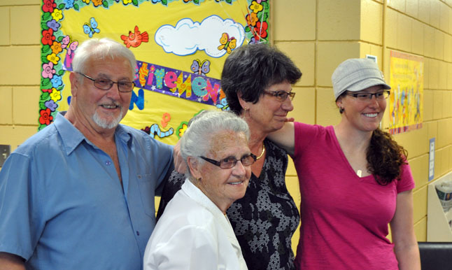 Head Librarian Joan Holzer didn't shed a tear during the retirement party thrown for her on her last day of work on Friday, but she certainly came close as you can see in this photo of her with her husband, Paolo, mother Candy Endrizzi and daughter, Amy. Dozens of appreciative library patrons attended the party at the Okanagan Regional Library. David F. Rooney photo