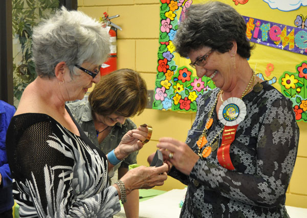 Gerri Farren presented Joan with a gold watch that doesn;t work so she doesn't have to worry about being on time. David F. Rooney photo