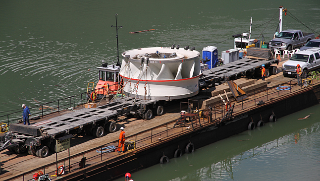 The barge for the Kin basket Lake portion  of its trip is owned by Downie Timber which was subcontracted for this job. Ron Ross photo courtesy of BC Hydro