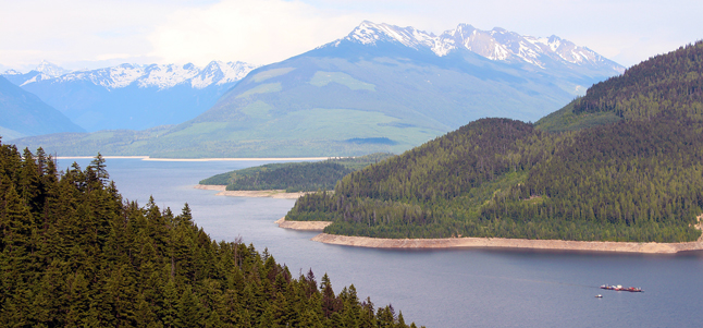 As large as it was the turbine-laden barge was dwarfed by the landscape. Jennifer Walker-Larsen photo courtesy of BC Hydro