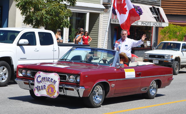 Citizen of the Year Dennis Berarduci waves to folks along the route. Dennis' hard work for minor hockey and other actvities over the years made him an ideal choice as Citizen of the Year. The story of his efforts on behalf od minor hockey won $20,000 for local hockey in the Kraft Hockey Goes On Contest this year. David F. Rooney photo