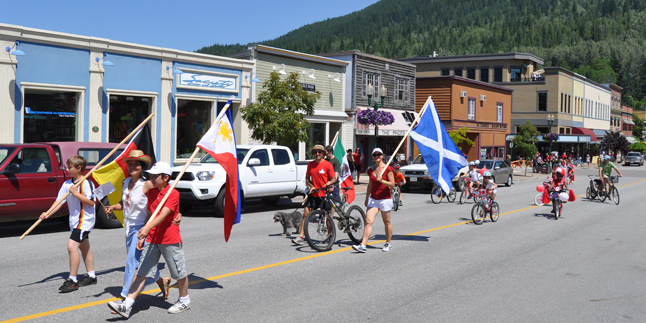 The Multicultural Society flag bearers were followed by kids on their gaily decorated bicycles. David F. Rooney photo