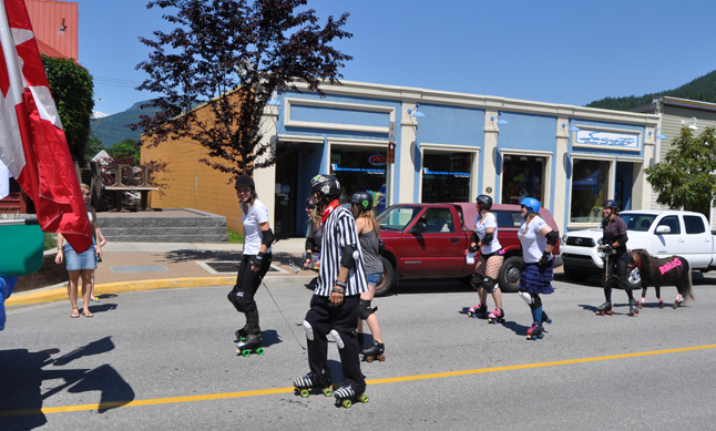 Some of the girls from the Revelstoke Derailers roller derby team skated their way through the parade, along with a four-legged mascot. David F. Rooney photo