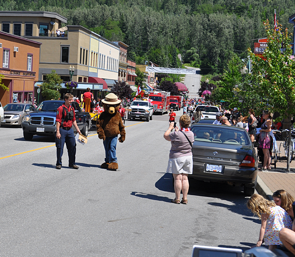Smokey the Bear pauses for a photo. Whoever was inside that costume must have been well and truly cooked by the end of the parade. Temperatures were right around 30° Celsius. David F. Rooney photo